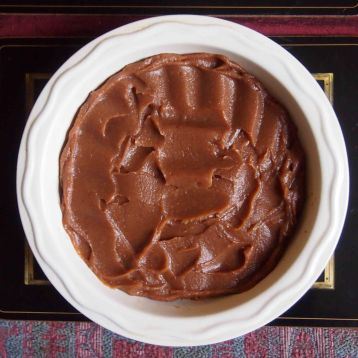 spread the date puree evenly over the biscuit base