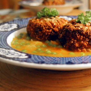 millet croquettes in a tomato and pea sauce