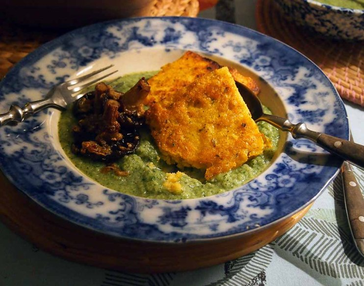 fried herby polenta in a broccoli and watercress sauce. vegan.