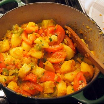 when potatoes are tender, add tomatoes, chillies and turn heat up