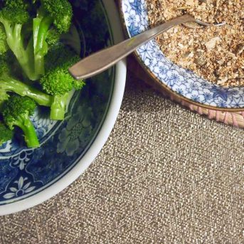 steamed broccoli and toasted ground seeds